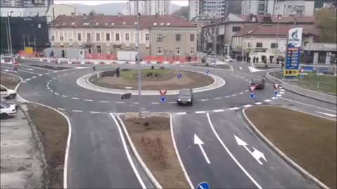 Driver in Serbia has no idea how roundabout works