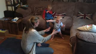 Baby takes his first steps and then applauds himself