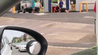 Two girls fighting at gas station - Video