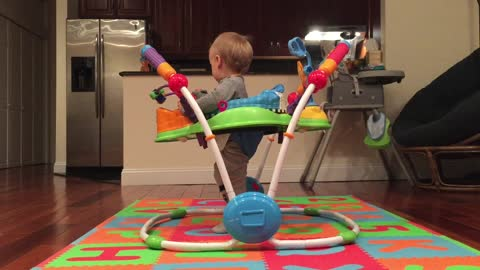 Funny baby jumps like crazy in toy