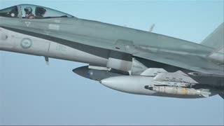 Royal Australia Air Force conducts first operational flight into Syria - Video
