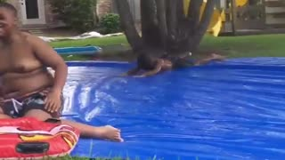 Collab copyright protection - little boy slips on slip n slide - Video