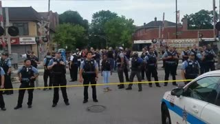 Protesters confront Chicago police after fatal shooting of armed man