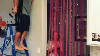 Guy blue ladder pops balloon scares girl - Video