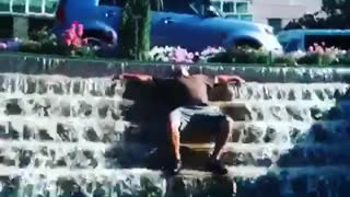 Man passed out on fountain - Video