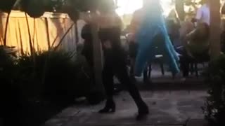 Lady blind folded misses blue pinata - Video