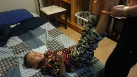 Boy gets wake up call from sneezing father