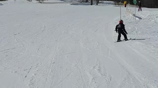 Fearless 5 year old skiing down the slopes
