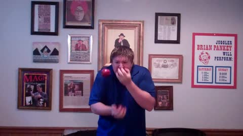 Man Juggles And Eats Three Apples At The Same Time