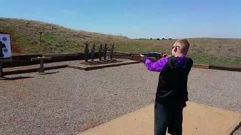 Little boy Instantly regrets trying to shoot a shot gun!