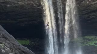 Insane 95ft double backflip off waterfall cliff - Video