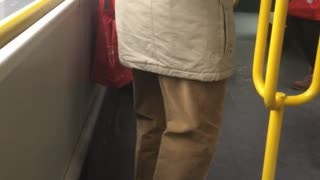 Man bends legs on subway train - Video