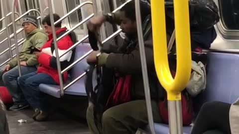 Man puts a lot of backpacks on his back on subway train