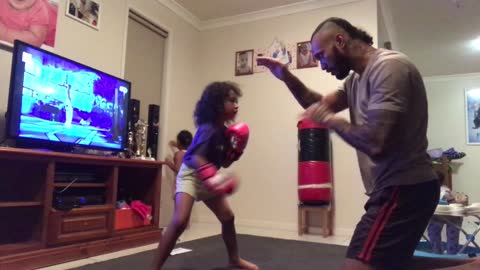 5-year-old girl trains with dad to become boxer