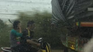Some People Will Do Anything To Keep Their Hair Dry - Video