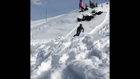 Snowboarder wipes out after landing big jump