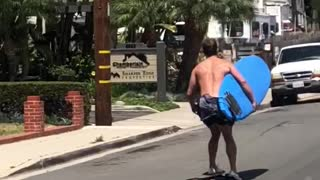 Man skating with blue surf board  - Video