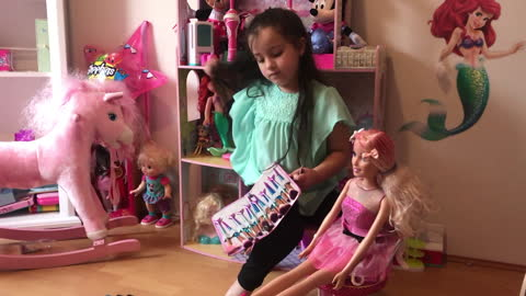 Little Girl Gives Life Size Barbie Doll a Makeover