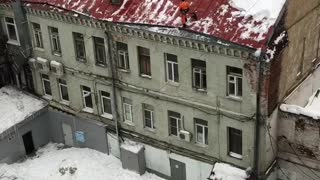 Worker Falls From Icy Roof