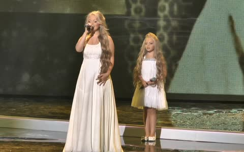 Two sisters enter the stage at a concert. Their performance will take your breath away.