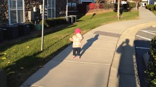 Little Girl Thinks She Is Stuck Behind A Sidewalk Crack - Video