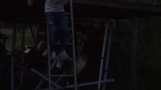 White shirt guy jumps off ladder and breaks foldable table - Video