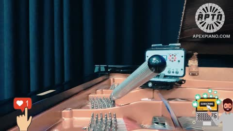 Watch a piano tuner tune unisons on a grand piano