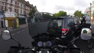 Motorcycle Crashes into Side of Vehicle - Video