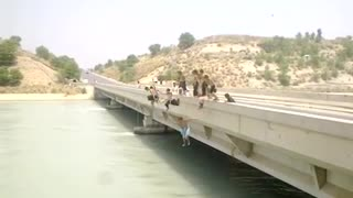Kids Jumping From A Bridge In Dam River For Swimming Race