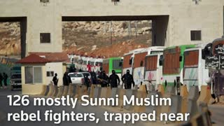 Hundreds of fighters and civilians escape besiege Syrian areas under U.N. deal - Video