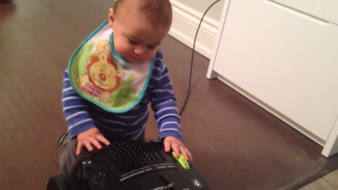 Baby Boy Fights Losing Battle With Vacuum Cleaner