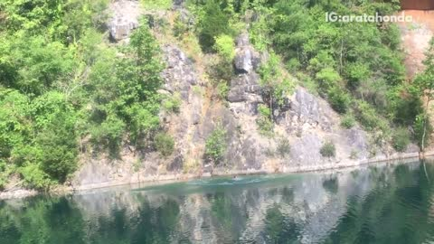 Guy jumps off cliff and belly flops into lake, gets bloody nose