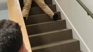 Guy in blue shirt falling down stairs  - Video