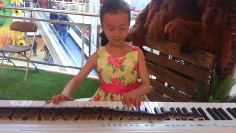 Even Snakes like music and little girls. Xuanna at 7 years old.