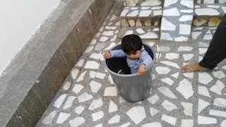 Cute kid went in bucket and came down through slide with bucket