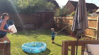Toddler gets hold of the cold water hose with hilarious results  - Video