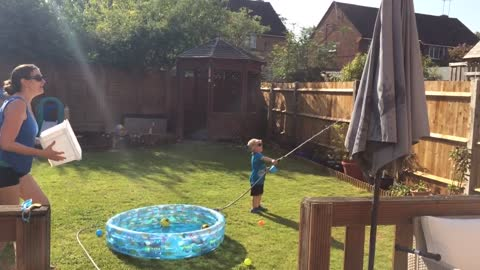 Toddler gets hold of the cold water hose with hilarious results