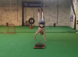 Handstand Walk While Pulling 90 lb. Weight!