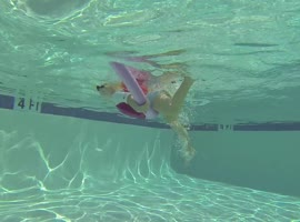 2-Year-Old Swims Through Hoops