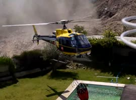 Helicopter Steals Water From Pool - Video