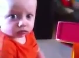 Cute Baby Scared By Party Horn - Video