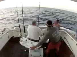 FISH JUMPS ONTO BOAT - Video