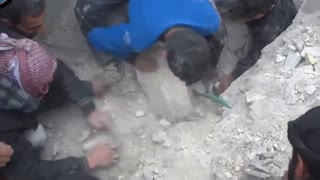 A Baby Buried In Rubble Rescued - Video