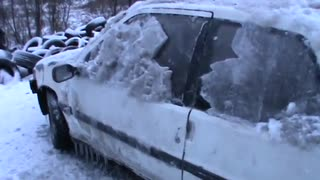 Using a Hammer to Defrost a Car - Video