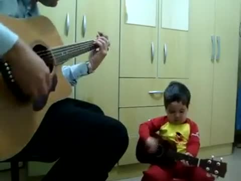 Year-Old Boy And His Dad Perform The Beatles' 'Don't Let Me Dow