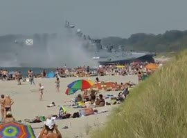 Military Hovercraft lands on Busy Beach