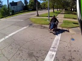 Good Guy Biker Helps Man in Wheelchair - Video
