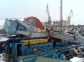 Crane Lowering Boat Collapses in Russia - Video