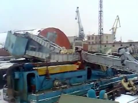 Crane Lowering Boat Collapses in Russia