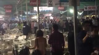 Chair Throwing Brawl During Mexican Festival